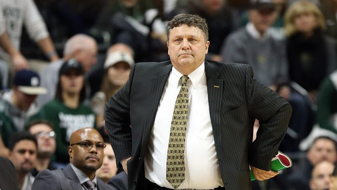 Dec 21, 2016; East Lansing, MI, USA;  Oakland Golden Grizzlies head coach Greg Kampe stands on the court during the first half of a game against the Michigan State Spartans at Jack Breslin Student Events Center.
