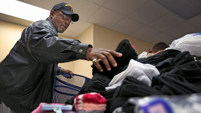 Veteran Whitney Hamilton helped unload almost 1,100 pairs of socks and about 60 pair of shoes to Hoosier Veterans Assistance Foundation of Indiana last year. The graduate of Back on My Feet will run in the Walt Disney World 5K with his grandson this week.