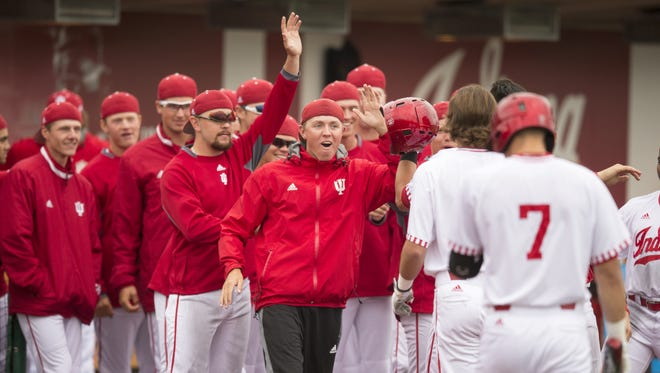 Indiana celebrates a two run seventh inning as IU beat Michigan 5-4 in 13 innings, the longest game in Big Ten baseball tournament history, Bloomington, Thursday, May 25, 2017.