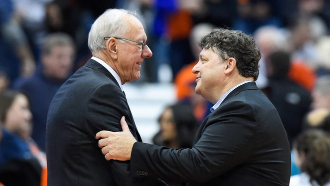 Syracuse coach Jim Boeheim and Oakland coach Greg Kampe shake hands following the game at the Carrier Dome  on Monday, Nov. 20, 2017.