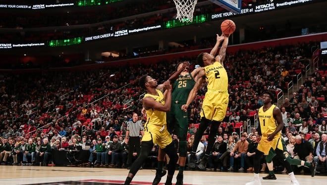 Oakland's Nick Daniels (2) battles for a rebound with Michigan State's Kenny Goins (25) during the first half of the Hitachi College Basketball Showcase at Little Caesars Arena in Detroit, Saturday, Dec. 16, 2017.