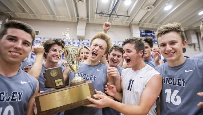 The Higley Knights accept their trophy following their 3-2 win against against the American Leadership Academy Patriots in the 5A Boys Volleyball State Championships at Mesquite High School on Friday, May 11, 2018 in Gilbert, Arizona.
