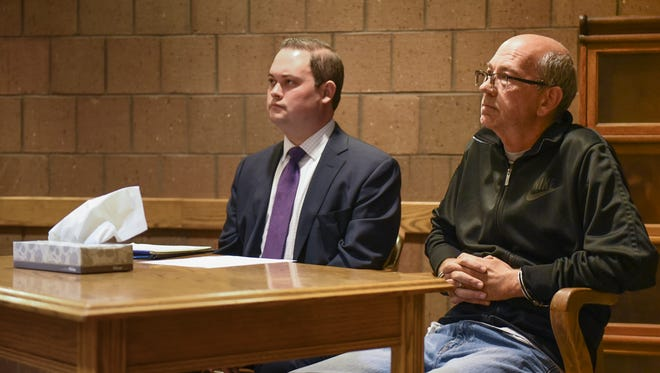 Joseph Hattey, right, 51, of Holt, faces Magistrate Mark Blumer, Monday, June 4, 2018 in 55th District Court. Hattey has been charged with two counts of sodomy for committing a crime against nature (bestiality). Seated next to him is his attorney, Alex Rusek.