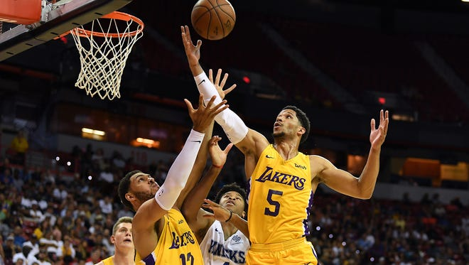 Los Angeles Lakers guard Josh Hart (5) reaches for a rebound during the first half against the New York Knicks at Thomas & Mack Center.