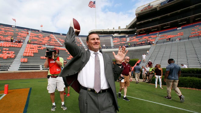 Mississippi State Bulldogs head coach Dan Mullen throws a football before the game against the Auburn Tigers at Jordan-Hare Stadium. Mandatory Credit: John Reed-USA TODAY Sports