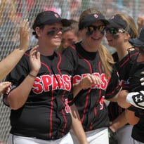 SPASH's Aubrey Drohner (13) is hugged by teammate Payton Gaber after Drohner doubled with the bases loaded and scored on a throwing error on the play to extend the Panthers lead to 5-0 as they beat Chippewa Falls on Saturday as they played in Plover.