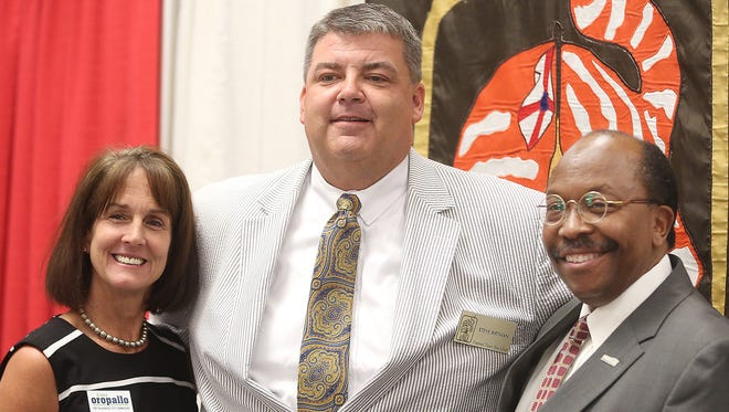 Candidates for City Commission Seat 2 Diana Oropallo, left, and Curtis Richardson, far right, pose with Capital Tiger Bay Club Vice President Steve Birtman Thursday.