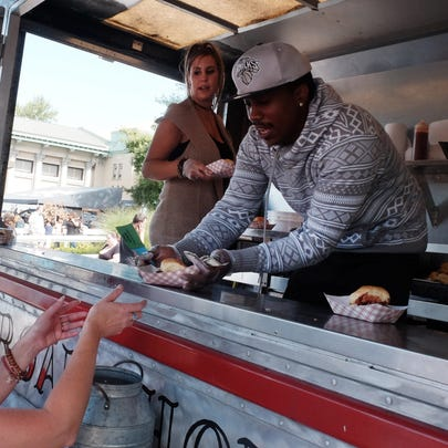 Limp Lizard BBQ serves food during the first day of