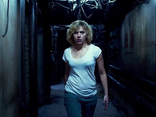 movie review lucy won t stretch your brain capacity