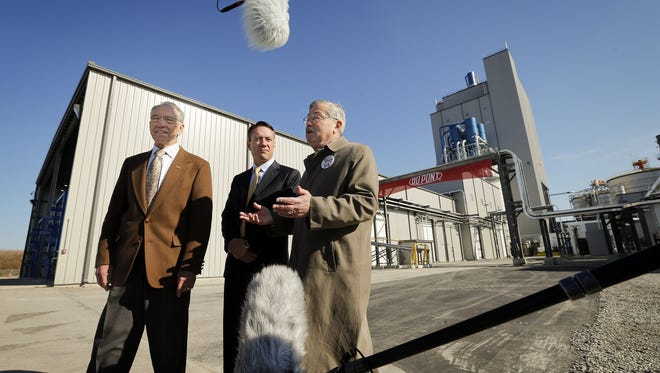 Sen. Charles Grassley stands with William Feehery, of DuPont Biofuels, and then-Gov. Terry Branstad in 2015 at the opening of DuPont's cellulosic ethanol facility in Nevada.