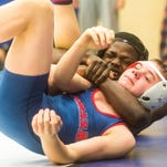 Sussex Central's Rashad Stratton (128-lb) grapples with Octorana's (PA) Troy Sharpless during War on the Shore on Friday, Jan 15 at Stephen Decatur High School.