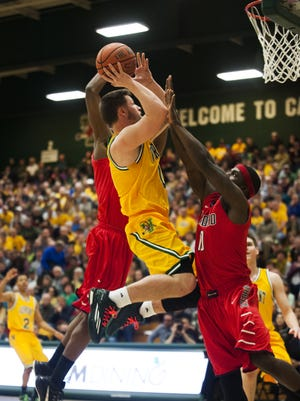 Vermont guard Brandon Hatton (0) leaps for a layup during the College Basketball Invitational quarterfinal game between the Radford Highlanders and the Vermont Catamounts in March. Hatton has decided to transfer, the school said Monday.