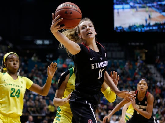 Stanford's Alanna Smith (11) grabs a rebound against Oregon during the first half of an NCAA college basketball game in the final of the Pac-12 women's tournament Sunday, March 10, 2019, in Las Vegas. (AP Photo/John Locher)