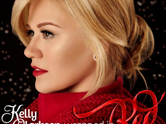 """This CD cover image released by RCA shows """"Wrapped in Red,"""" a holiday album by Kelly Clarkson. (AP Photo/RCA)"""