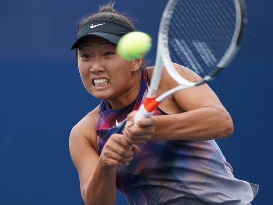 Claire Liu returns the ball to Ying-Ying Duan of China during their first-round match Monday at the U.S. Open. Liu, a 17-year-old, lost in two tiebreakers in her U.S. Open main-draw debut.