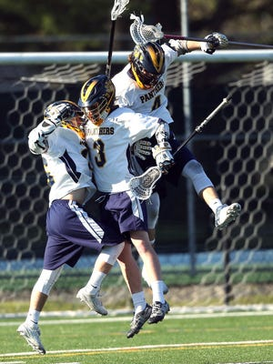 Pequannock celebrates Liam Lilienthal's game tying goal making the score 8-8 vs. Roxbury during their boys lacrosse matchup. The Panthers came from behind to win 9-8. April 14, 2016. Pequannock, N.J.