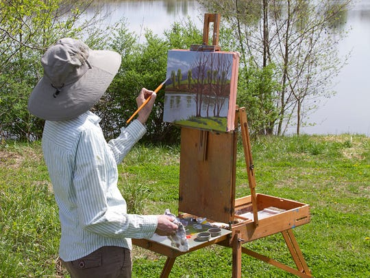 Artist Debra Sheffer at Gaie Lea during the 2015 Augusta Garden Tour. Sheffer will be back for the Queen City Plein Air Festival this April.