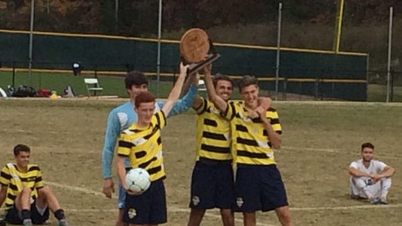 Asheville Christian Academy's four seniors hold up the NCISAA 2-A trophy on Saturday.