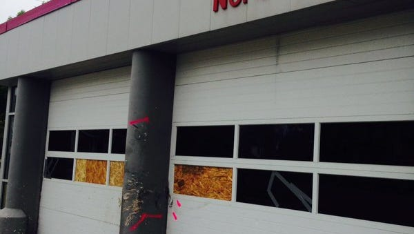 Windows at a Des Moines fire station are boarded up after a car crashed into the station May 8.