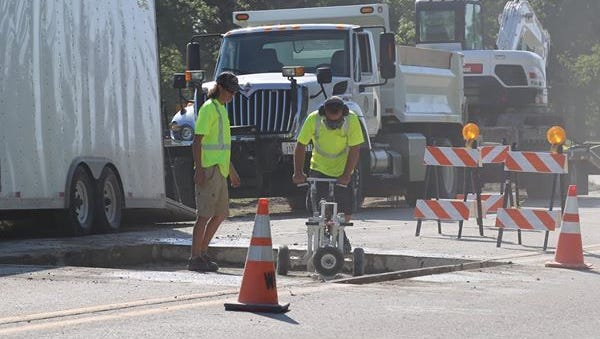 Some roads in Waukee may be reduced to one lane as crews patch holes caused by the extreme heat and humidity over the weekend.