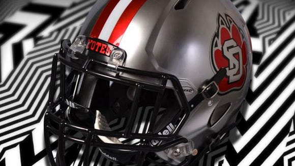 USD's new alternative helmet has a strip down the middle, the paw/USD logo and a black facemask.