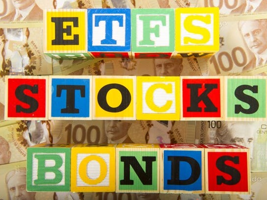 "Building blocks arranged to read ""ETFS"" ""STOCKS"" and ""BONDS"""
