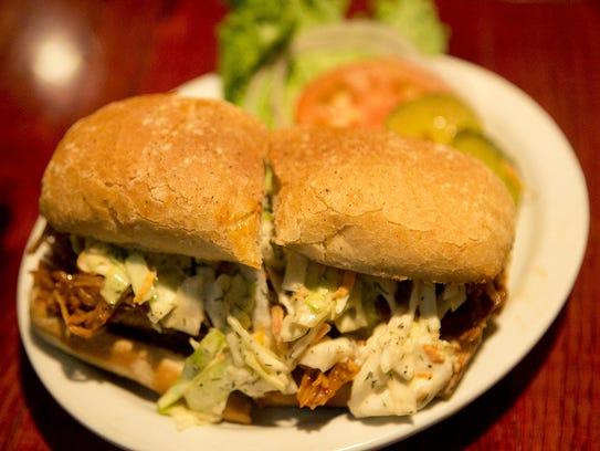 The Mudpuppy sandwich, which is a pulled-pork sandwich