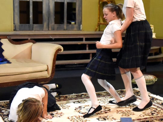 """Hailey Harper (left) Alyssa Chaffee (center) and Nadia Scharf rehearse a fight scene as the cast of """"Children's Hour"""" at D'Alto studio."""