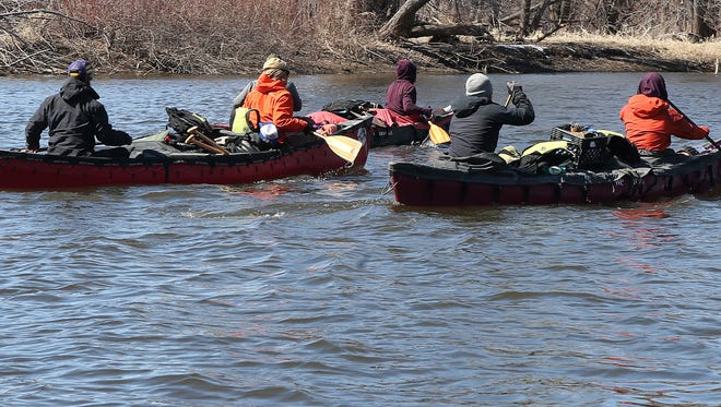 A group of six friends, including two Iowa natives, row up the Mississippi River on March 28 in La Crosse, Wis.
