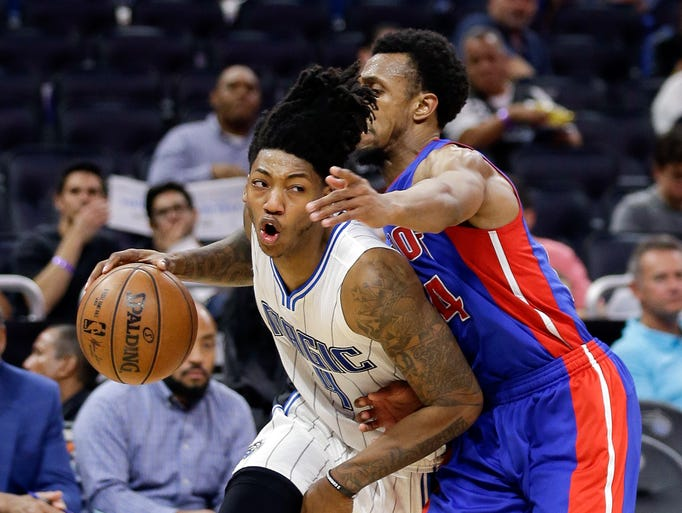 Orlando Magic's Elfrid Payton, left, drives to the