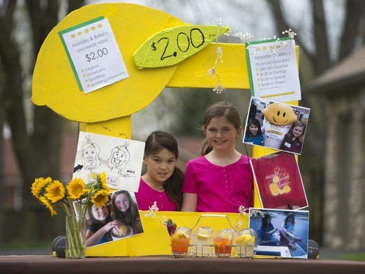 Best friends Maddie Abbott (left), and Bella Deaton, operated a lemonade stand for Lemonade Day 2013.