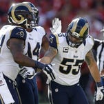 St. Louis defensive end Eugene Sims, left, defensive end Robert Quinn, center, and middle linebacker James Laurinaitis helped the Rams upset the San Francisco 49ers on Sunday.