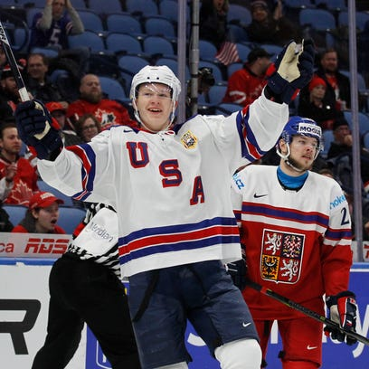FILE - In this Jan. 5, 2018 file photo, United States forward Brady Tkachuk (7) celebrates a goal during the second period in the bronze medal game of the world junior hockey championships against the Czech Republic in Buffalo, N.Y.  Former NHL star Keith Tkachuk already has one son, Matthew, following in his footsteps. Soon, there could be a second. Brady Tkachuk, 18, is considered the top U.S-born draft prospect after his freshman season at Boston University.(AP Photo/Jeffrey T. Barnes)