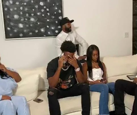 In this still image from video provided by the NFL, CJ Henderson talks on the phone during the NFL football draft Thursday, April 23, 2020. The Jacksonville Jaguars selected Henderson in the first round of the NFL draft. (NFL via AP)