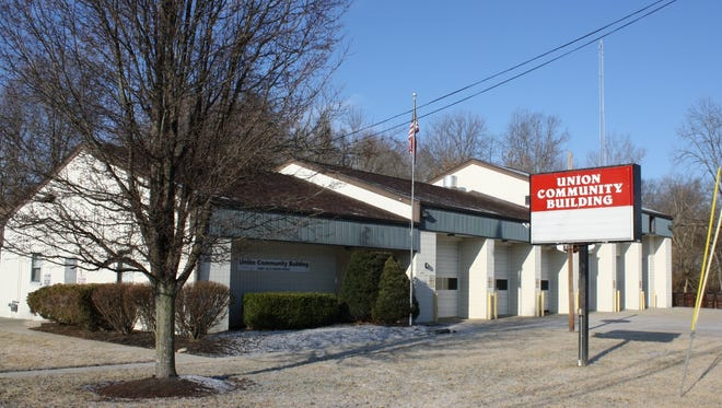 Garage bays built for fire trucks line the front of the Boone County city of Union's closed community building at 10087 Old Union Road. The city will sell the former firehouse purchased in 2008 for $375,000.