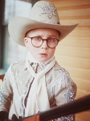 "Ralphie (Peter Billingsley) fantasizes about his ideal Christmas gift - a Red Ryder BB gun - in ""A Christmas Story."""