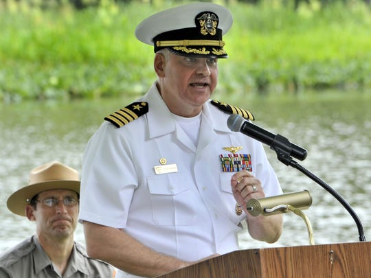 Navy Capt. Scott Starkey on Tuesday speaks at a ceremony