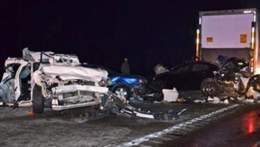 Some of the eleven vehicles involved in an accident lie on Interstate 10 in Hancock County, in Kiln, Miss., on Saturday Dec. 13, 2014. Officials say says four people were killed and four injured when a tractor-trailer plowed into traffic stopped on the interstate in coastal Mississippi.