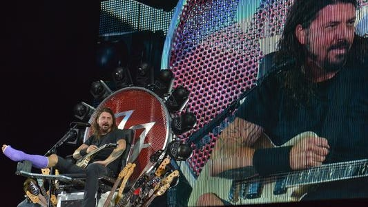 Dave Grohl, lead singer of rock band Foo Fighters, performs during the band's 20th anniversary concert at RFK Stadium in Washington, D.C. on July 4, 2015.