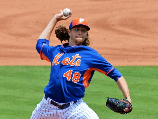 New York Mets starting pitcher Jacob deGrom throws against the Washington Nationals during spring training.