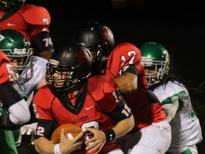 Hillcrest's Collin Sneed (12) pushes for an unsuccessful attempt at extra point.