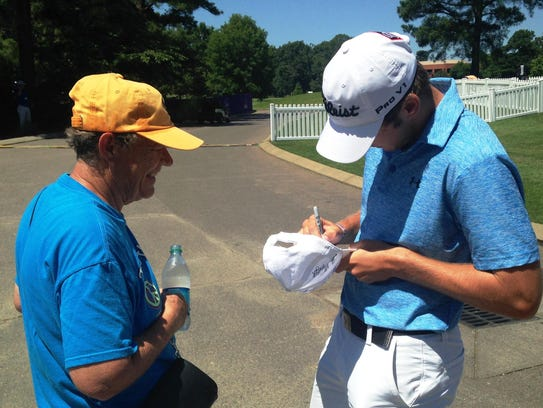 Shreveport's Sam Burns signs an autograph before Tuesday's