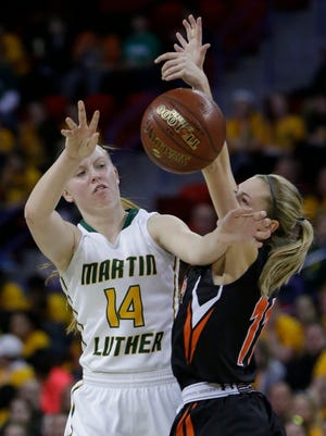 Bloomer's Shaina Zwiefelhofer (11) plays tight defense on Greendale Martin Luther's Bonnie Jensen (14) during their WIAA girls basketball Division 3 state semifinal Thursday, March 9, 2017 at the Resch Center in Ashwaubenon.