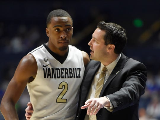 Vanderbilt Commodores head coach Bryce Drew talks to guard Joe Toye (2) during the first half of their game in the 2017 SEC Men's Basketball Tournament at Bridgestone Arena Thursday, March 9, 2017 in Nashville, Tenn.