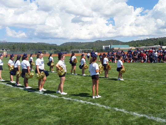 Cheerleaders from Ruidoso Middle School prepare to