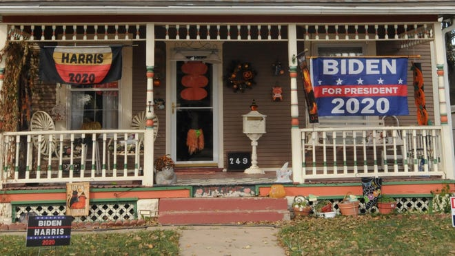 Joe Biden flags and Halloween decorations cover the porch owned by Shirley Haugh in the 200 block of N. Columbia in Salina.