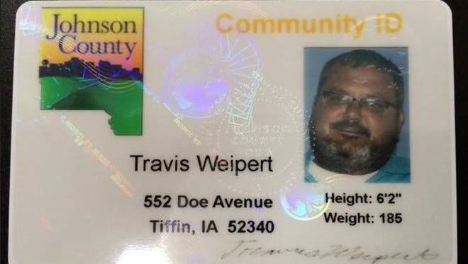Johnson County Auditor Travis Weipert shares a prototype of what the Johnson County community ID will look like.