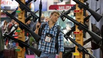 The gun industry is holding its biggest annual trade show just a few milesfrom the site where a gunman slaughtered 58  Las Vegas concertgoers in October.