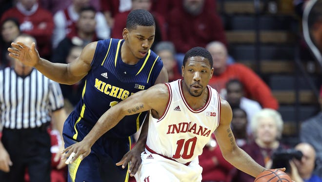 Indianaâ??s Evan Gordon keeps the ball away from Michiganâ??s Derrick Walton,left, in the second half of their game Sunday, January 2, 2014, afternoon at Assembly Hall in Bloomington IN. The Hoosiers defeated the Wolverines 63-52.