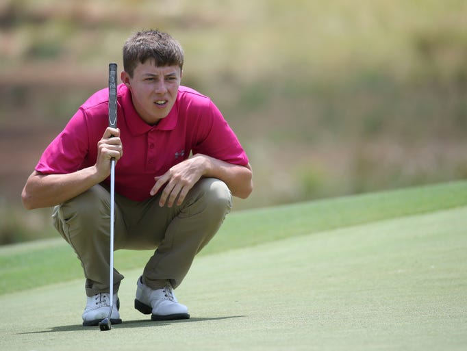 Matthew Fitzpatrick lines up his putt on the second hole during the second round.